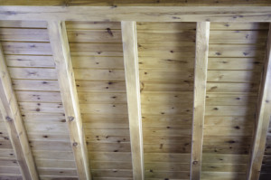 Interior view of a wooden roof structure with wood beam
