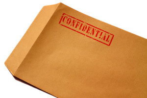 Envelope confidential. Manila envelope with confidential stamped on it.