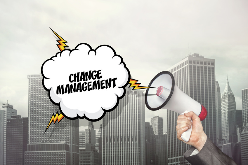Change management text on speech bubble and businessman hand holding megaphone