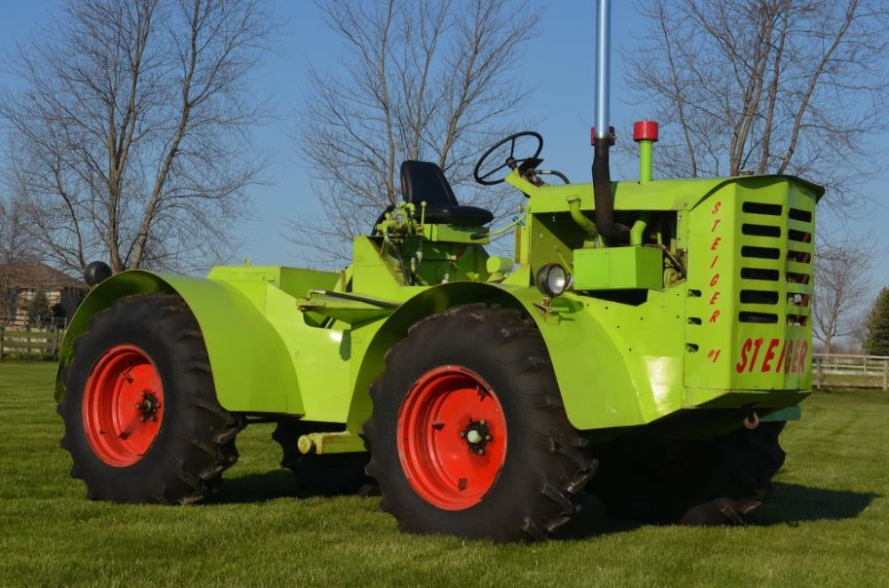 The first Steiger tractor ever sold to the public. Just one of numerous articulated 4WD tractors in this huge auction.